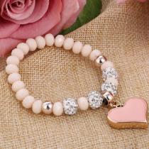 Joli bracelet  rose avec ses perles strass et sa breloque en cœur assorti