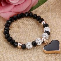 Joli bracelet noir avec ses perles strass et sa breloque en cœur assorti